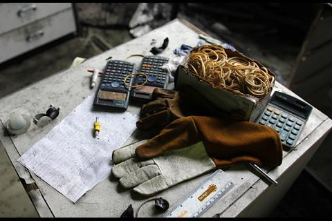 A picture showing gloves and calculators in the fire aftermath